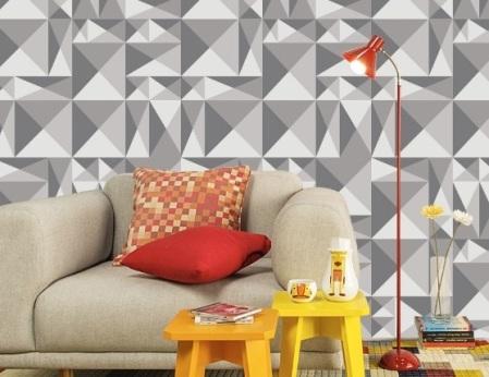 papel-de-parede-com-estampa-geométrica-em-cinza-e-almofadas-coloridas
