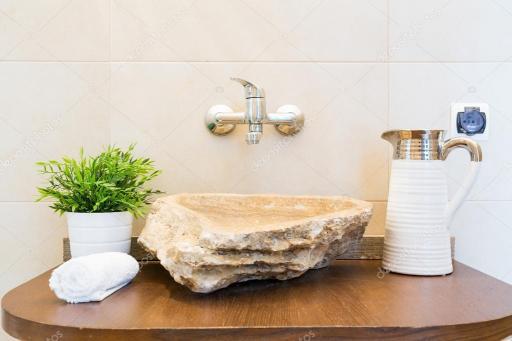 depositphotos_128469722-stock-photo-creative-shape-bathroom-sink